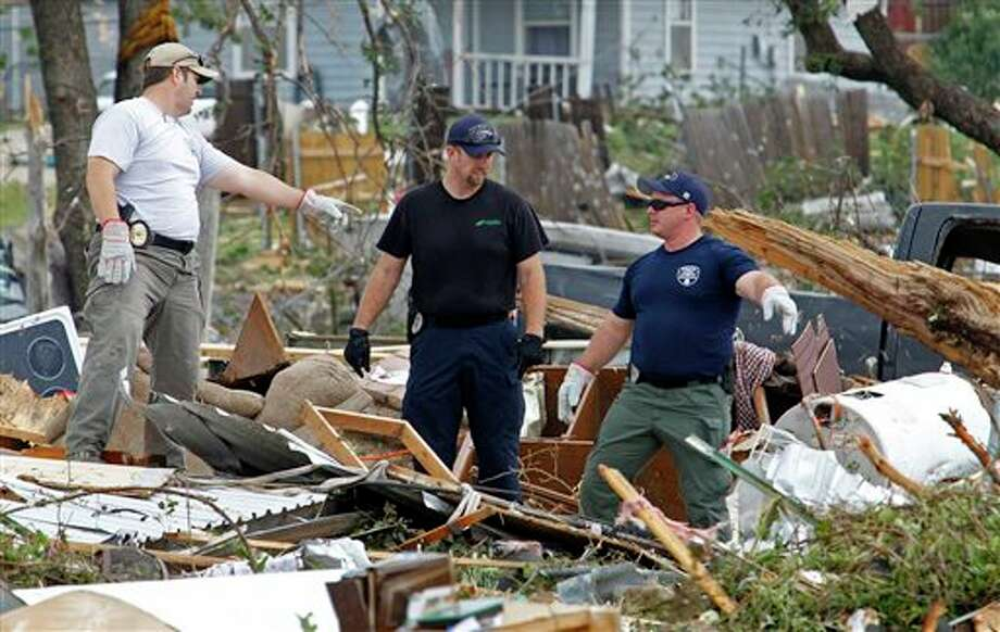 Emergency personnel continue search efforts to locate people in the destroyed Rancho Brazos neighborhood of Granbury, Texas, Thursday, May 16, 2013. Ten tornadoes touched down in several small communities in North Texas overnight, leaving at least six people dead, dozens injured and hundreds homeless. (AP Photo/The Fort Worth Star-Telegram, Paul Moseley) MAGS OUT; (FORT WORTH WEEKLY, 360 WEST); INTERNET OUT Photo: Paul Moseley / Fort Worth Star-Telegram