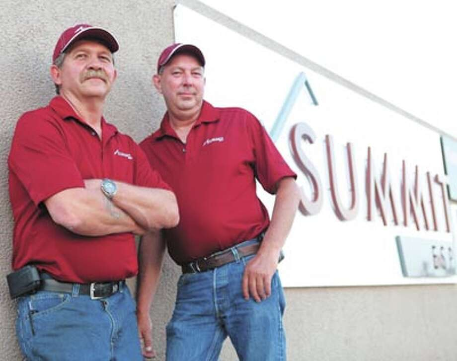 Reliability is at the forefront, from design to manufacture to installation at Summit ESP. Call them at 432-563-7040 to put that quality to work for you. Pictured are David Jolly and Freddie Walton)