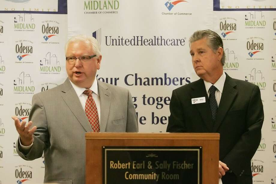 Midland and Odessa Chamber of Commerce Presidents and CEOs Bobby Burns, left, and Mike George announce the launch of the Permian Basin Health Insurance Cooperative which will provide health insurance, at a discounted rate, to businesses affiliated with the chambers. Cindeka Nealy/Reporter-Telegram Photo: Cindeka Nealy