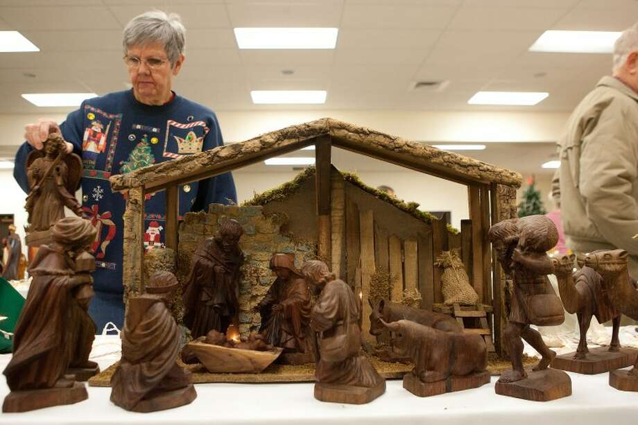"Edie White adds the final piece to her hand-carved Ecuadorian Nativity scene Friday during preparation for the 2010 ""No Room at the Inn"" exhibit at Grace Presbyterian Church. Cindeka Nealy/Reporter-Telegram Photo: Cindeka Nealy"
