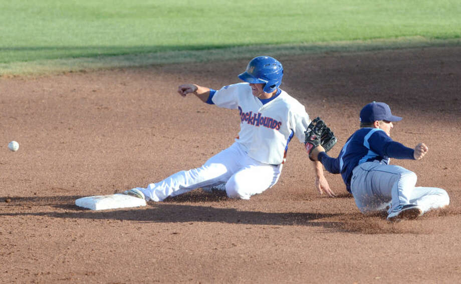 RockHounds' Chad Oberacker safely steals second base as Corpus Christi second baseman Enrique Hernandez loses control of the ball Tuesday at Citibank Ballpark. James Durbin/Reporter-Telegram Photo: JAMES DURBIN