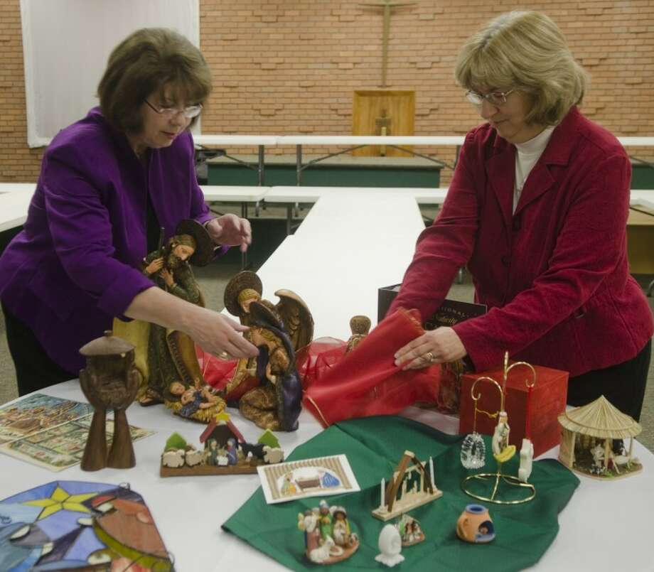 Donna Edney, left and Cheryl Homsher set up part of the display for No Room at the Inn at Grace Presbyterian Church. Photo by Tim Fischer/Midland Reporter-Telegram Photo: Tim Fischer