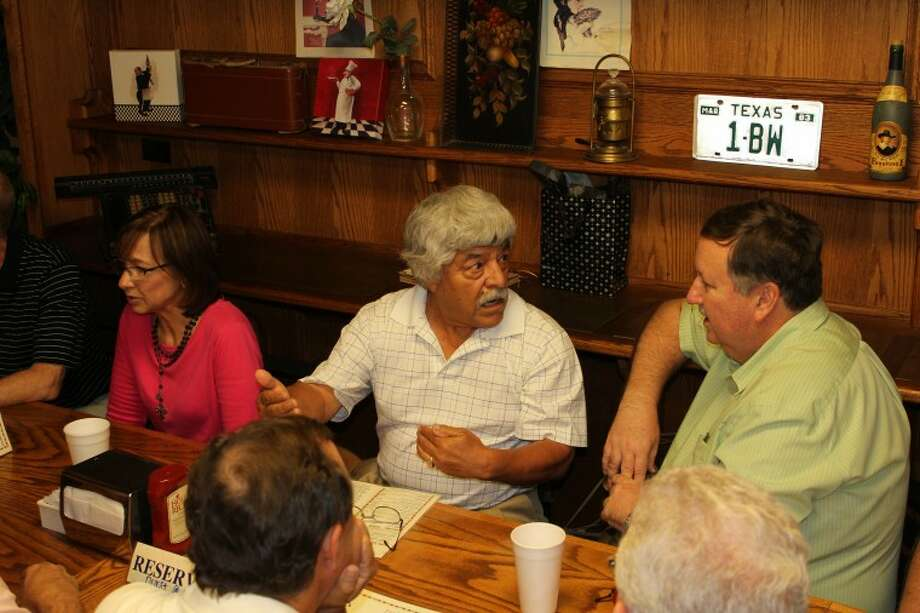Meredith Moriak/Reporter-Telegram Retired Midland ISD teacher Miguel Bustilloz talks with former students who returned to town for their 40th class reunion Friday at Murray's Deli. Bustilloz retired from MISD in 2003 after teaching 39 years in the junior high and freshman schools. Photo: Meredith Moriak/Reporter-Telegra