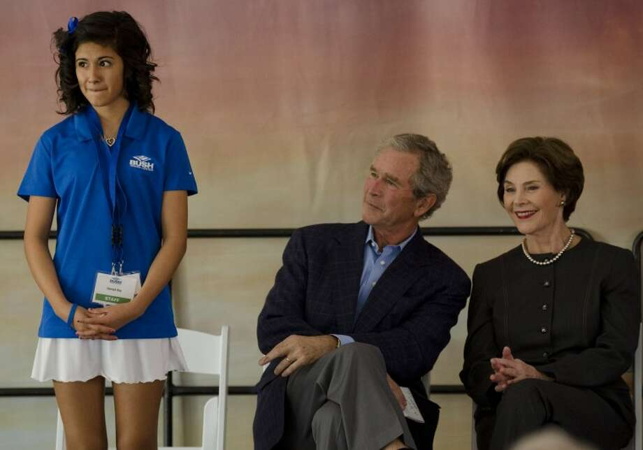 George and Laura Bush look on as Hannah Rey, a young tennis sensation, is introducted Friday during the Bush Tennis Center dedication. Photo: Tim Fischer/Reporter-Telegram