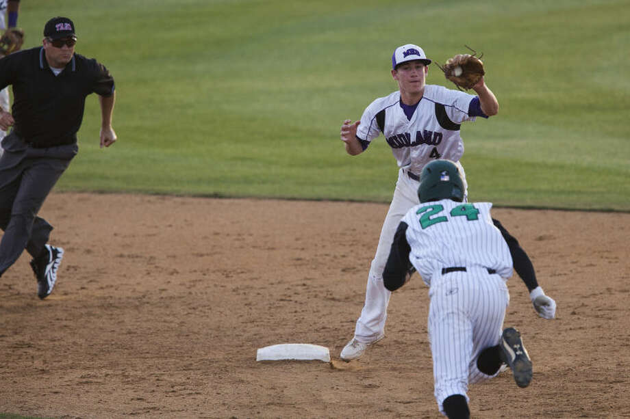 Midland High second baseman Jason Raughton forces out Southlake Carroll's Joe Heineman during the 5th inning of the first game of a class 5A regional quarterfinal series at John J. Hunter field on the campus of Hardin Simmons University in Abilene Friday evening. photo by Gary Rhodes Photo: Photographer: Gary Rhodes