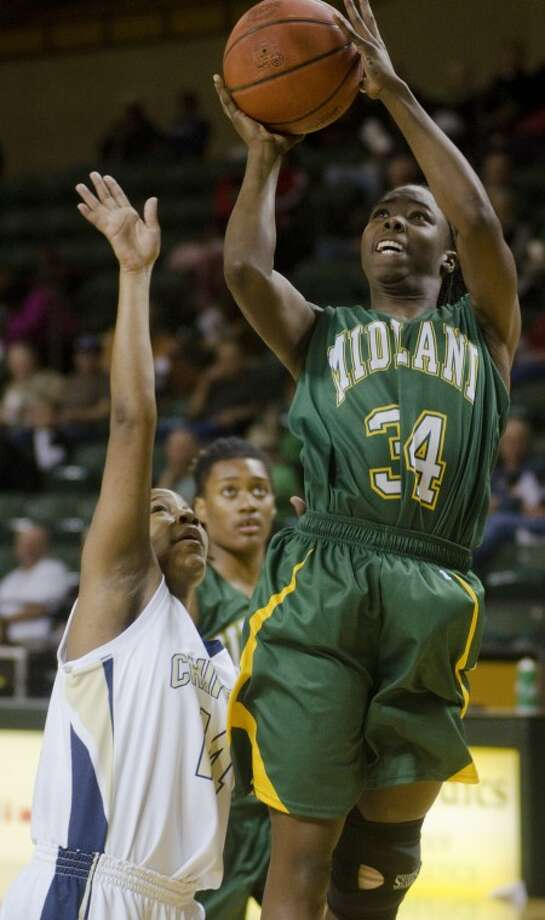 Midland College's Danesha Long puts up a shot over Chipola College's Denaya Brazzle Friday night in the semifinal game of the Women's National Invitational Tournament. Photo by Tim Fischer/Midland Reporter-Telegram Photo: Tim Fischer