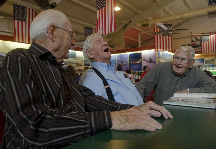 Bill Womack, Wayne Bonner and Jerry Morgan, WWII veterans who all fought in Italy, meet for the first time Friday and quickly start telling stories and jokes. Photo by Tim Fischer/Midland Reporter-Telegram Photo: Tim Fischer