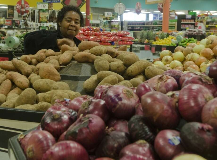 Betty Ford picks out some yams Monday at Super Mercado to prepare for her Thanksgiving feast Photo by Tim Fischer/Midland Reporter-Telegram Photo: Tim Fischer