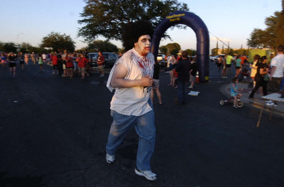 "Runners participate in Midland's inaugural ""Zombie Run"" Saturday at Midland College. James Durbin/Reporter-Telegram Photo: JAMES DURBIN"