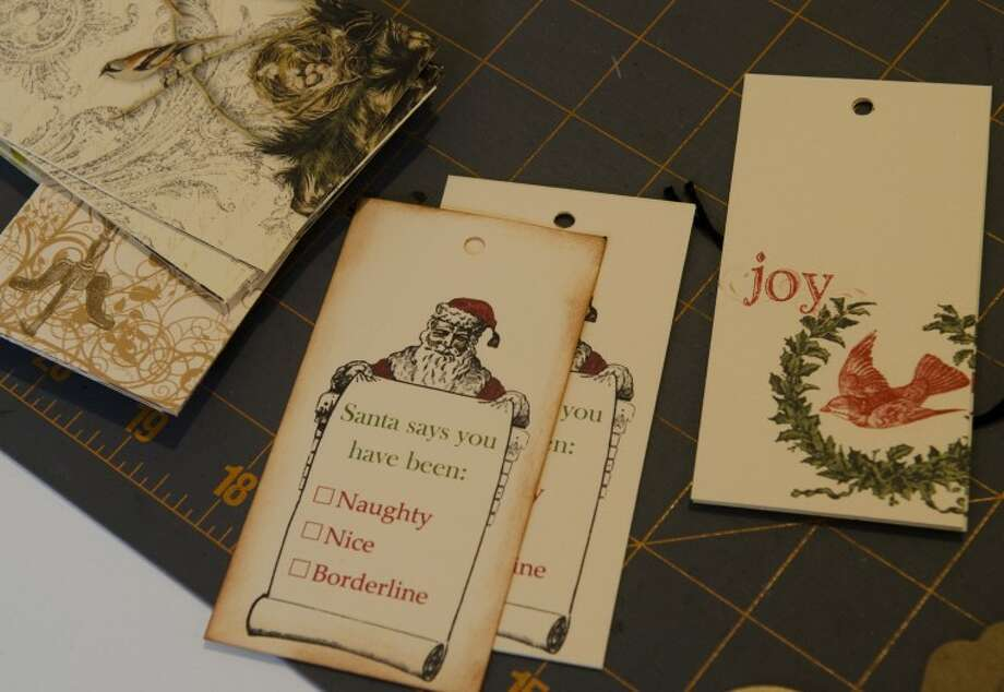 Some of the card designs Lisa Graves has completed. Photo by Tim Fischer/Midland Reporter-Telegram Photo: Tim Fischer