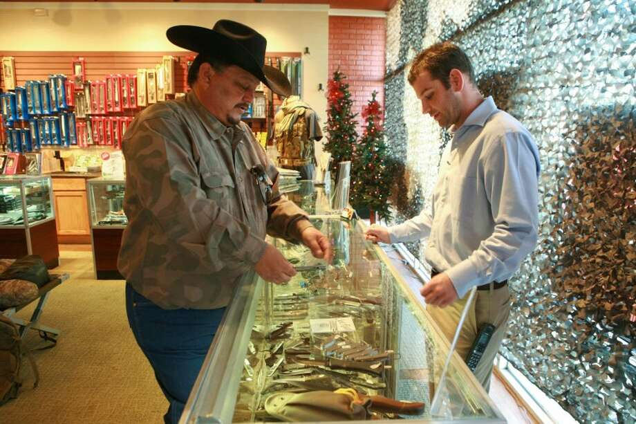 Ruben Ortega, left, shops for knives to give to his hunting guides for Christmas last week at Bear Claw Knife and Shear. Photo: Cindeka Nealy/Reporter-Telegram