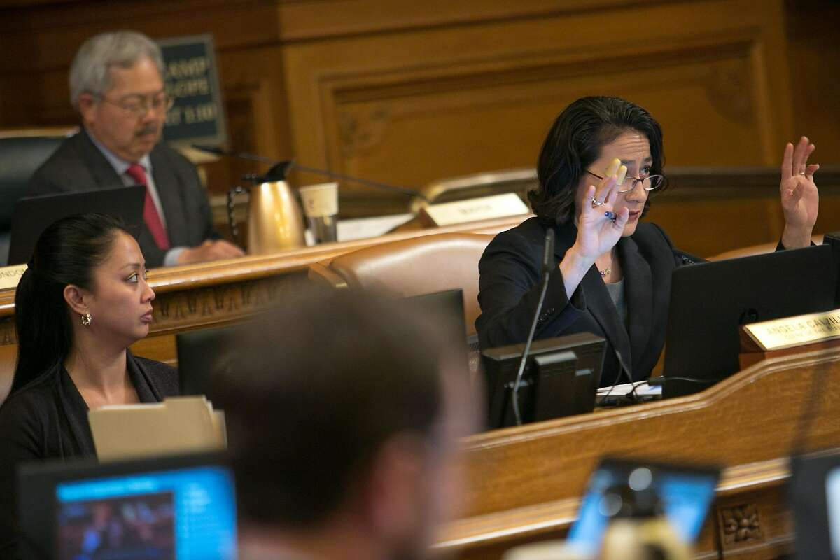 Angela Calvillo, clerk of the board, asks audience members to use their hands to show support or not instead of yelling out, during a Board of Supervisors meeting at City Hall on Tuesday, May 10, 2016 in San Francisco, Calif.