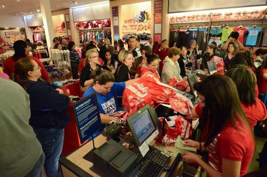 FILE -- Customers line up to pay for their items Friday morning at Aeropostale in Midland Park Mall.