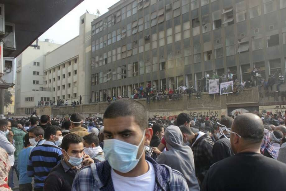 Egyptian protesters crowd a street near clashes with security forces in downtown Cairo wearing surgical masks to protect themselves from heavy teargas. Photo: Maggie Hyde/MRT Contributor