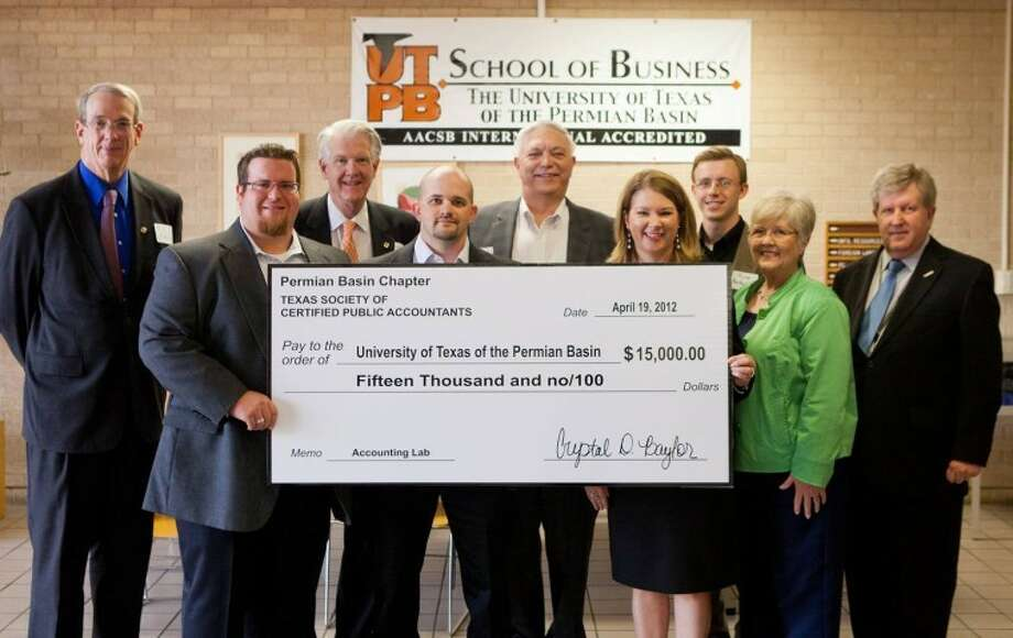 The Permian Basin Chapter of Texas Society of CPAs recently presented $15,000  for an accounting lab and library at the University of Texas of the Permian Basin. On hand for the presentation were William Fannin, vice president of Academic Affairs, from left; Jimmy Hudson, Permian Basin Chapter of TSCPA;  UTPB President David Watts; Billy Kelley, Phil Davis, Crystal Baylor and Ryan Bartholomee, all with the Permian Basin Chapter of TSCPA; Shirley Davenport, associate professor of accounting; and Jack Ladd, dean of School of Business. Photo: Courtesy Photo