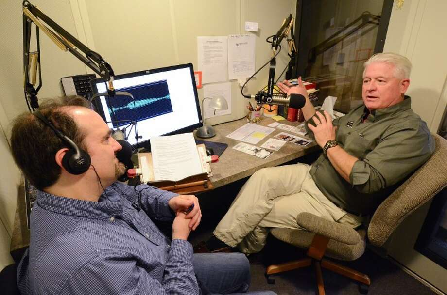 """Michael Todd, left, interviews Hal Combs, Petroleum Museum's education and program director, Tuesday at the Recording Library of West Texas. The library launched a radio show where staff interviews area nonprofits and organizations, which is then broadcast during the """"Connections"""" segment. Photo: Cindeka Nealy/Reporter-Telegram"""