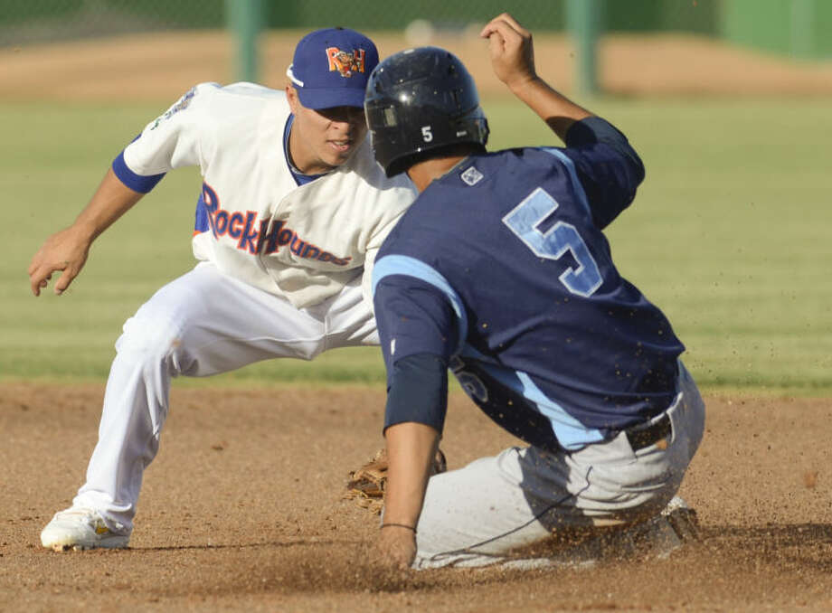 RockHounds' Darwin Perez gets the ball and makes the tag as Hooks' Jiovanni Mier is tagged out on a steal attempt at second Monday evening at CitiBank Ballpark. Tim Fischer\Reporter-Telegram Photo: Tim Fischer