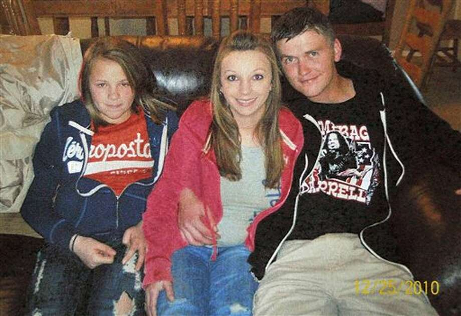 FILE - This Dec. 25, 2010 file photo provided by Clint Dunn shows his 13-year-old daughter, Hailey Dunn, left, poses for a photo with her mother Billie Jean Dunn, center, and her mother's boyfriend Shawn Adkins on Christmas day in Colorado City, Texas. Authorities in West Texas on Friday, April 26, 2013, confirmed the remains found in a remote part of Scurry County in March are those of Hailey Dunn, who has been missing since December 2010. (AP Photo/Courtesy of Clint Dunn, File) Photo: Uncredited / Clint Dunn