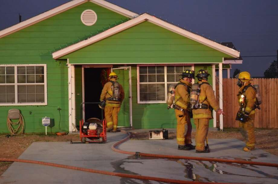 Firefighters quickly extinguish a residential fire Saturday on the 300 block of South Tilden Street.