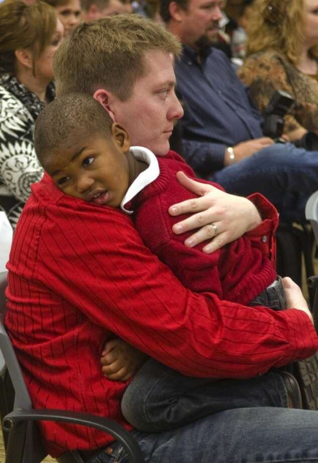 Zane Nieland holds his soon-to-be adopted son Brooks during court hearings Wednesday during National Adoption Day proceedings at the Midland County Courthouse. Photo by Tim Fischer/Midland Reporter-Telegram Photo: Tim Fischer