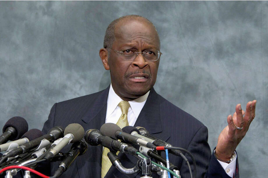 FILE - In this Nov. 2, 2011 file photo Republican presidential candidate Herman Cain speaks on Capitol Hill in Washington.  (AP Photo/Carolyn Kaster, File) Photo: Carolyn Kaster / AP