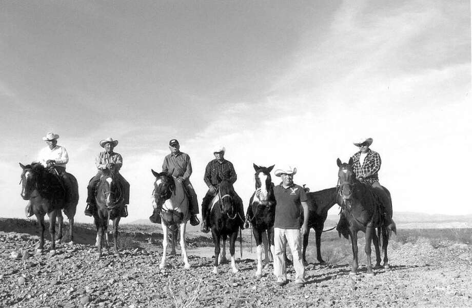 Johnny Rodriguez, standing, took his five uncles from Midlandto Big Bend National Park during the Veterans Day weekend to ride horses and to follow some of the trails the brothers' father, Juan Gamboa, had explored with them when they were children. Photo: Courtesy Photo