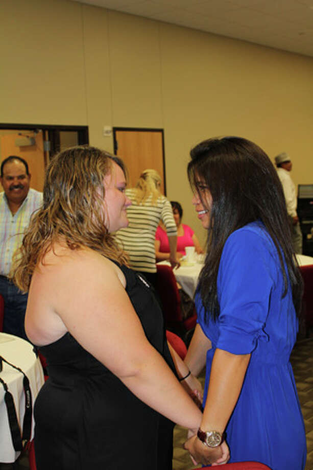 MidlandHigh Schoolgraduate Amanda Turnbow, left, celebrates with Andrea Morales, MHS' Communities in Schools campus liaison Monday evening at a graduates recognition ceremony and dinner. Turnbow credits Morales' guidance and perseverance with helping her stay motivated to graduate from high school.   Photo: Meredith Moriak/Reporter-Telegram
