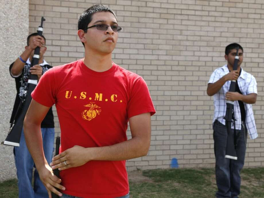Lee High senior Darien Ramos leads ROTC practice Wednesday afternoon behind the school. Ramos graduates today and heads to Marine basic training on Sunday. Photo: Chaney Mitchell/Reporter-Telegram
