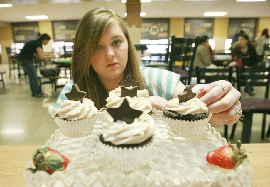 Amber Jennings set up her chocolate velvet cupcake display Saturday during the Far West Texas Cupcake Battle at Midland High School. Jennings is among a group of high school Culinary Arts students competing in the baking and presentation contest with the hopes of advancing to the state competition. Jennings a senior at Midland Hgih School placed 1st and was awarded best of show. Cindeka Nealy/Reporter-Telegram Photo: Cindeka Nealy