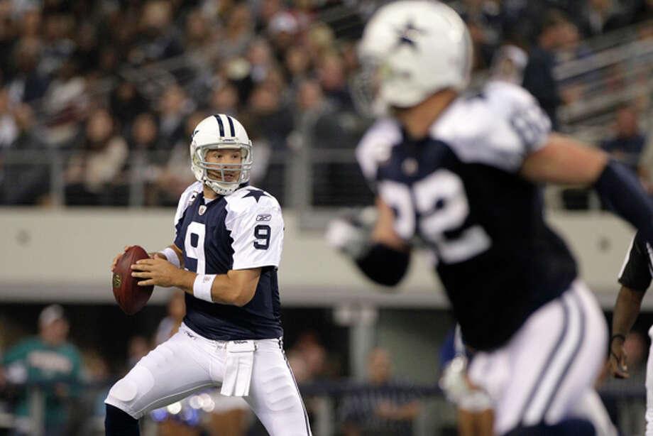 Dallas Cowboys quarterback Tony Romo (9) and tight end Jason Witten (82) during an NFL football game against the Miami Dolphins Thursday, Nov. 24, 2011, in Arlington, Texas. (AP Photo/Matt Strasen) Photo: Matt Strasen / FR170476 AP