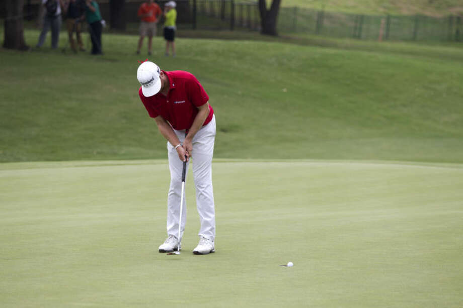 Keegan Bradley watches his putt horseshoe out during the final round of the Byron Nelson golf tournament Sunday, May 19, 2013, in Irving, Texas. Bradley finished two strokes behind tournament champion Sang-Moon Bae. (AP Photo/Tony Gutierrez) Photo: Tony Gutierrez