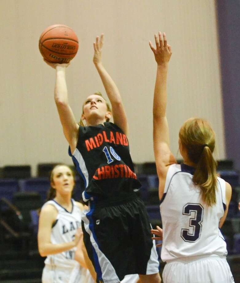 Midland Christian's Morgan Ashton (10) shoots a two-pointer Tuesday at Midland Classical Academy. Photo: Cindeka Nealy
