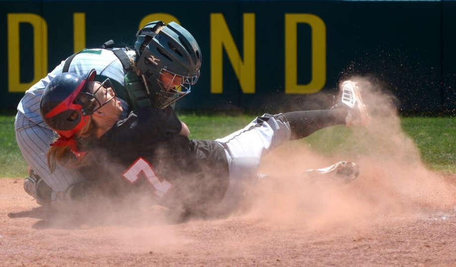 Midland College catcher Amy Anderson tags out Howard College's Rebecca Long at home plate Friday at the Midland College softball field. James Durbin/Reporter-Telegram Photo: JAMES DURBIN