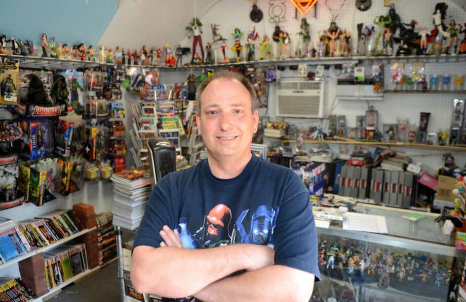 """Keely Newton, owner of Thunderstruck Comics & Collectibles, stands in his shop he operates from his home in Midland on """"Free Comic Book Day,"""" Saturday, May 4, 2013. James Durbin/Reporter-Telegram Photo: JAMES DURBIN"""