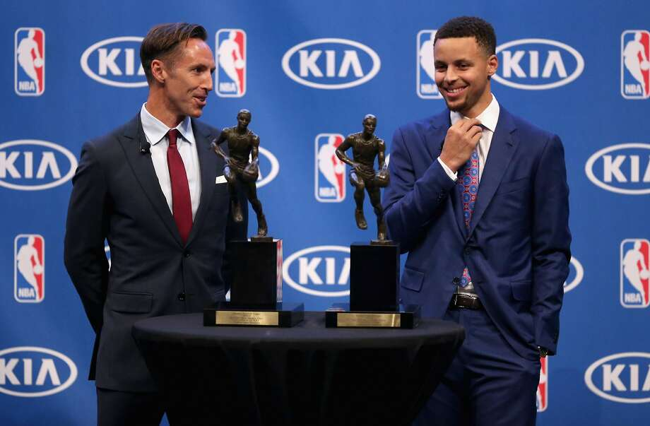 Stephen Curry (right) of the Golden State Warriors stands next to his back-to-back NBA Most Valuable Player Awards and former MVP Steve Nash during a press conference at ORACLE Arena on May 10, 2016 in Oakland, California. Photo: Ezra Shaw, Getty Images