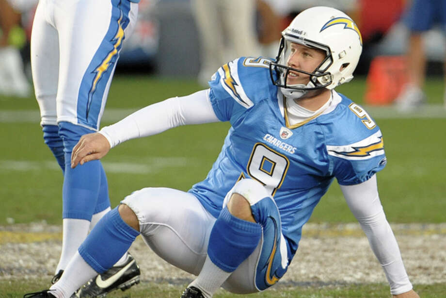 San Diego Chargers kicker Nick Novak (9) falls on the ground after missing a field goal in overtime during an NFL football game against the Denver Broncos Sunday, Nov. 27, 2011 in San Diego. The Broncos won 16-13. (AP Photo/Denis Poroy) Photo: Denis Poroy / FR59680 AP