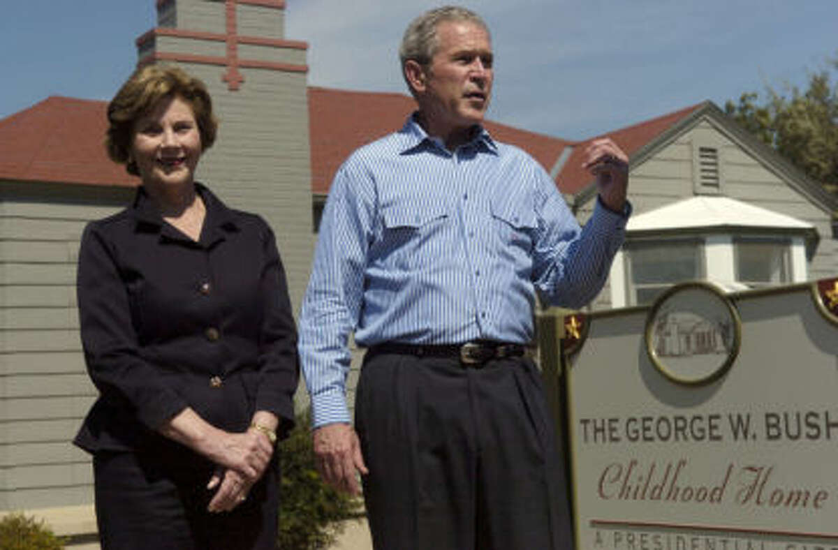 Former President George W. Bush and former First Lady Laura Bush stand outside of his childhood home Midland.The National Park Service held a virtual public meeting Tuesday to discuss the process of designating the George W. Bush Childhood Home as a national park.