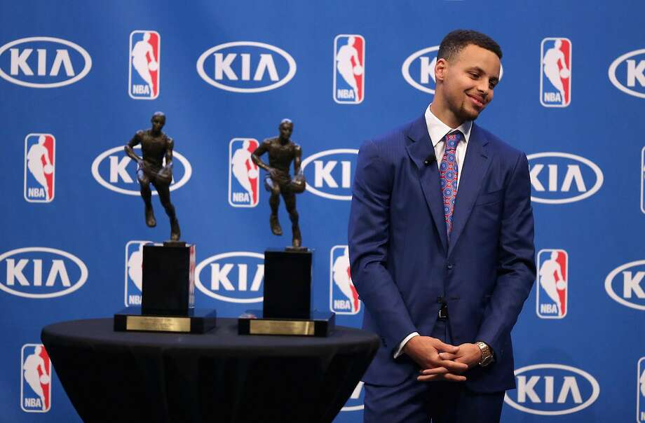 OAKLAND, CA - MAY 10:  Stephen Curry of the Golden State Warriors stands next to his back-to-back NBA Most Valuable Player Awards during a press conference at ORACLE Arena on May 10, 2016 in Oakland, California.  NOTE TO USER: User expressly acknowledges and agrees that, by downloading and or using this photograph, User is consenting to the terms and conditions of the Getty Images License Agreement.   (Photo by Ezra Shaw/Getty Images) Photo: Ezra Shaw, Getty Images