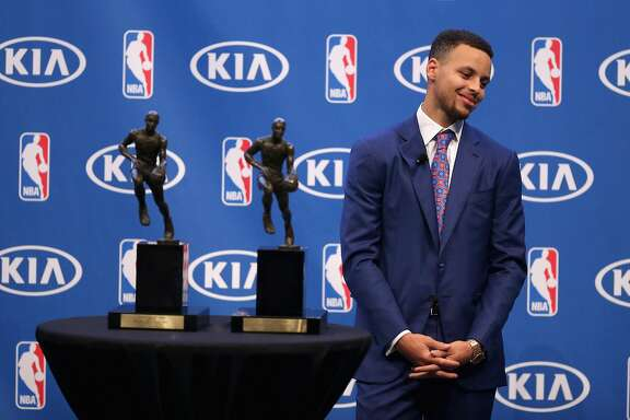 OAKLAND, CA - MAY 10:  Stephen Curry of the Golden State Warriors stands next to his back-to-back NBA Most Valuable Player Awards during a press conference at ORACLE Arena on May 10, 2016 in Oakland, California.  NOTE TO USER: User expressly acknowledges and agrees that, by downloading and or using this photograph, User is consenting to the terms and conditions of the Getty Images License Agreement.   (Photo by Ezra Shaw/Getty Images)