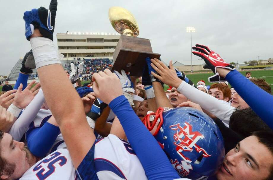 No. 1 Story of 2011Members of the Midland Christian football hoist their TAPPS Division II State Championship trophy into the air after defeating Concordia Lutheran 35-23 Saturday at Leo Buckley Stadium, Killeen. Cindeka Nealy/Reporter-Telegram Photo: Cindeka Nealy