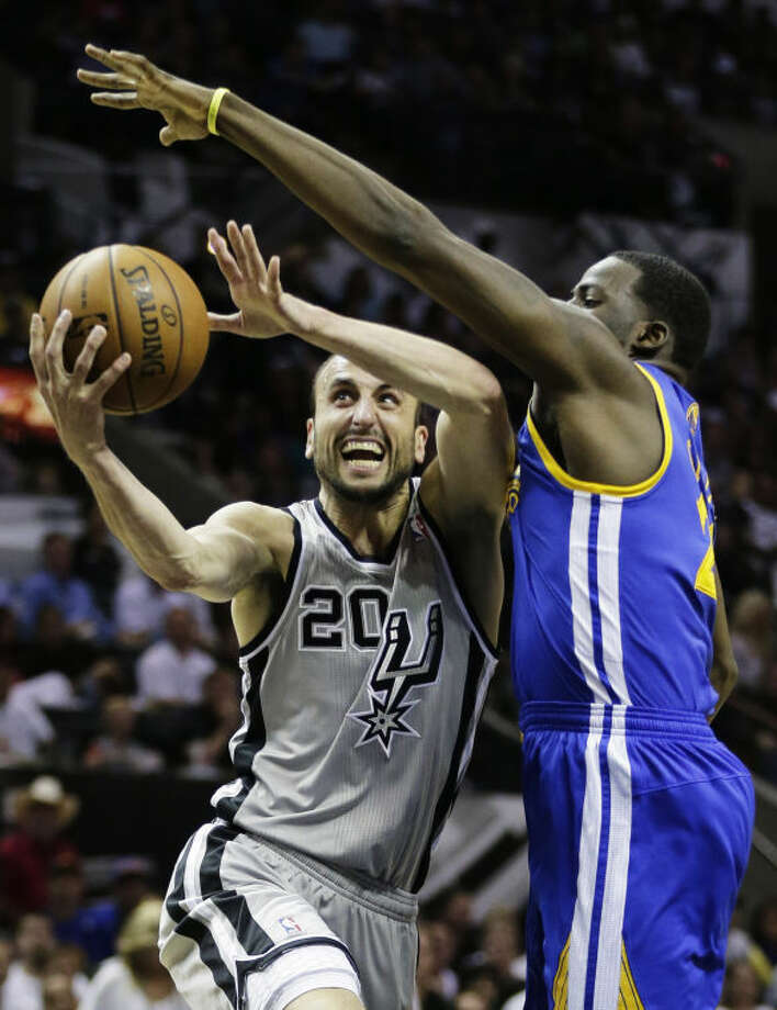 San Antonio Spurs shooting guard Manu Ginobili (20) shoots against Golden State Warriors' Draymond Green during the first half of Game 1 of a Western Conference semifinal NBA basketball playoff series, Monday, May 6, 2013, in San Antonio. (AP Photo/Eric Gay) Photo: Eric Gay