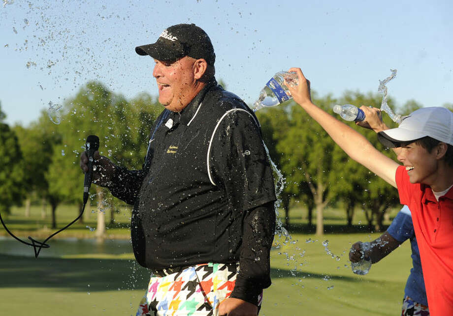 Thomas Metthe/Reporter-News Andrews girls coach Mark Burgen gets doused with water by players Brittney Lambert (right) and Sarah Black after the completion of Andrews' final round of the Class 3A girls state golf tournament on Friday, May 3, 2013, at Jimmy Clay Golf Course in Austin. Photo: Thomas Metthe