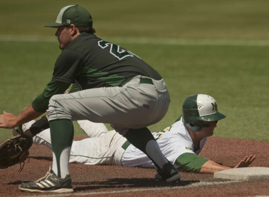 Midland College's Chris Shaw dives back to first to beat the pickoff attempt as Western Texas' Alex Kline reaches for the ball Friday afternoon at Christensen Stadium. Tim Fischer\Reporter-Telegram Photo: Tim Fischer