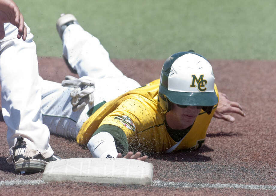 Midland College's Joel Atkinson beats a pick-off attempt at first base during the game against Clarendon Saturday at Christensen Stadium. James Durbin/Reporter-Telegram Photo: JAMES DURBIN