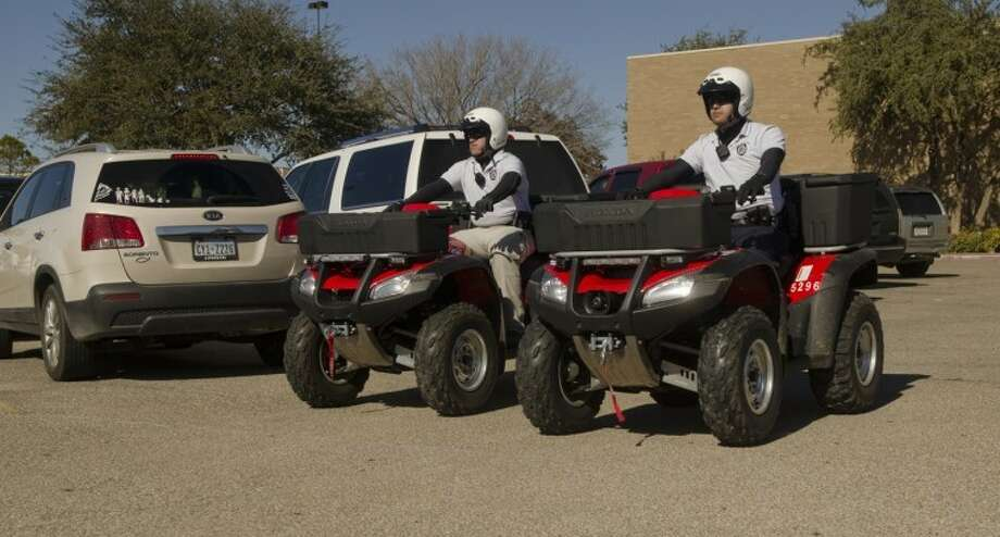 Midland Police Officers Stephen Truex and Eliud Amparan patrol the mall parking lot on ATVs Saturday afternoon. Photo by Tim Fischer/Midland Reporter-Telegram Photo: Tim Fischer