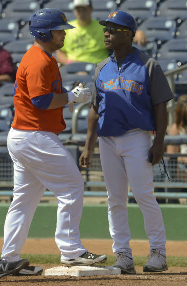 RockHounds firstbase coach Rickey Henderson, talks with Hounds' Miles Head as he gets on base Tuesday at the afternoon RockHounds game at CitiBank Ballpark. Tim Fischer\Reporter-Telegram Photo: Tim Fischer