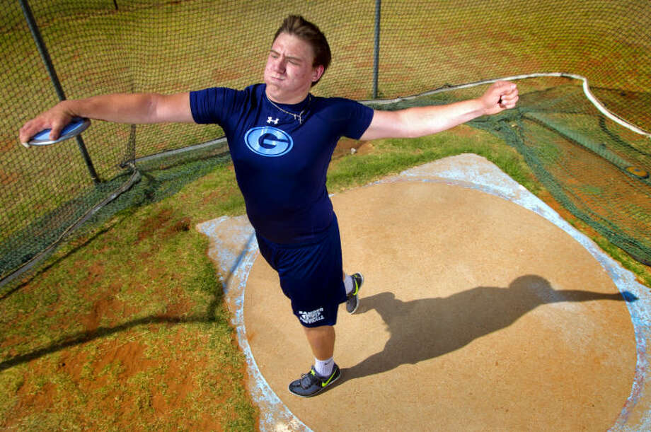 Jody Lively will represent Greenwood in the discus throw during the state track meet this weekend in Austin. Portrait photograph taken Wednesday, May 8, 2013 at the Greenwood track facility. James Durbin/Reporter-Telegram Photo: JAMES DURBIN