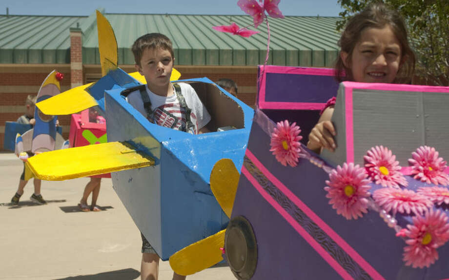 Greathouse Elementary kindergarteners participate in a Transportation Parade around the school Thursday afternoon. after finishing a lesson learning about different types of transportation for land air and sea. Tim Fischer\Reporter-Telegram 5-9-13 Photo: Tim Fischer