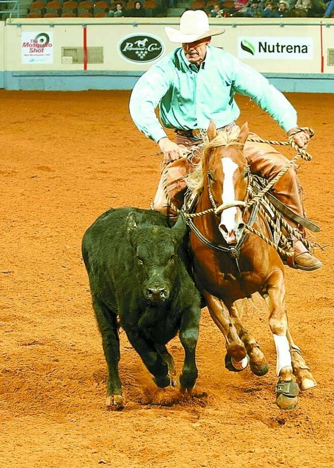 Trainer Tom Neel works a cow while riding Zackly Right Time, known to its owners as Peyton, during the 2011 American Quarter Horse Association World Championship Show in November in Oklahoma City. Photo: Courtesy Photo