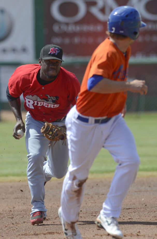 Rough Riders' Odubel Herrera chases after Hounds' Dusty Coleman as he gets caught in a rundown between second and third Tuesday afternoon at CitiBank Ballpark. Tim Fischer\Reporter-Telegram Photo: Tim Fischer